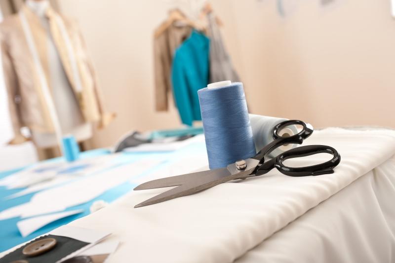 1606342-fashion-designer-studio-with-professional-equipment